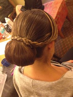 Hair bun low with delicate braid