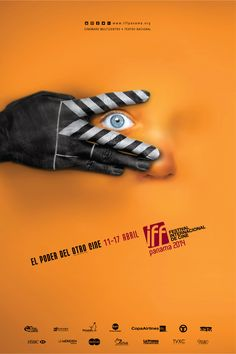 "Film festival promotion. ""The power of another cinema"" - This ad immediately stood out to me because of its bright orange color, excessive white space, and strange but fun image. The main message is nicely placed to where it can't be missed and there is great eye-flow throughout the ad which helps make it very visually pleasing. The image cleverly shows person's hand painted to represent a clapperboard while simultaneously conveying suspense or fear as they watch a movie."