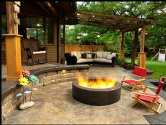 http://www.landexpressions.com:  stamped cement patio and fire pit.  note the natural seating area formed by the ledge of the upper level