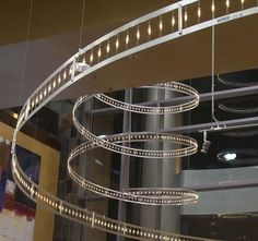 XSport Fitness Health Club with Bruck Flight Track - Two aluminum tracks are joined with festoon lamps or lamps and Swarovski Crystals. Monorail Gallery - Monorail Idea Photos - Brand Lighting Discount Lighting - Call Brand Lighting Sales 800-585-1285 to ask for your best price!