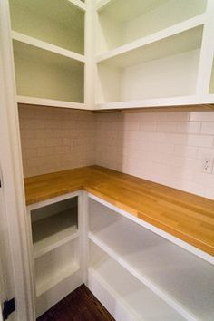 walk in pantry with open shelving and butcher block counter top
