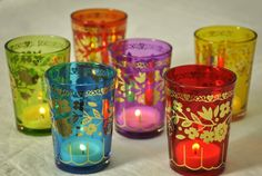 Brightly coloured tea light holders with gold foil bird and floral designs.  Look great for an ethnic style wedding table or mehndi celebration by www.fuschiadesigns.co.uk.