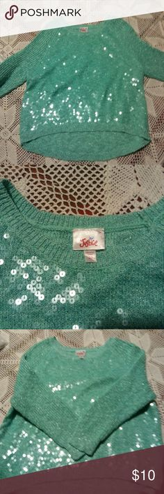 Sequined and warm sweater. Love this green. Shimmers with tons of sequen. Tag says size 20. Id say a large. Justice Shirts & Tops Sweaters
