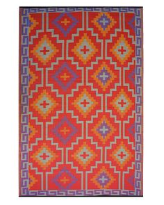 Outdoor Rugs: Lhasa rug by Fab Habitat; homeinfatuation.com.   Photographer: Geoffrey Sokol