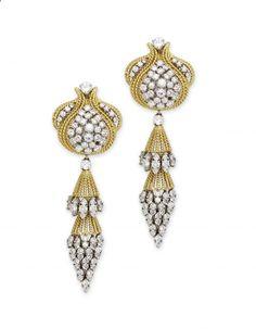 A Pair of Diamond and Gold Ear Pendants - Each designed as a stylised ropetwist surmount set with brilliant-cut diamonds suspending a detachable basket-shaped ropetwist pendant set with brilliant-cut-cut diamonds. Mounted in 18k gold and platinum. Circa 1950
