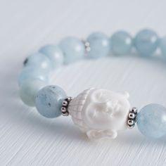 >> WHAT MATTERS MOST << carved bone buddha head and amazing aquamarin beads bracelet | www.apinchofsalt.net