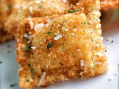 Toasted Ravioli  great finger food for a party serve w/marinara sauce.  can bake too: 400 deg. oven, spray each side w/cooking spray, place on wire rack lined baking sheet/ bake 20 min or so til browned.