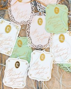 Monogrammed escort cards in green and white
