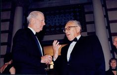 Henry Kissinger and James A. Baker, III confer at a Baker Institute for Public Policy event, 1997