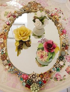 ... costume jewelry and mirror. recycled # repurposed # craft ideas