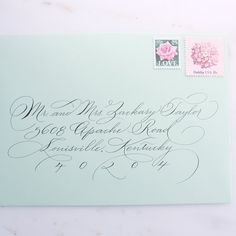 Classic early-American pointed pen calligraphy envelope addressing for any event by calligrapher, Amy Neubauer. Calligraphy is written with black
