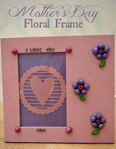 This Mother's Day Floral Frame makes a wonderful and inexpensive gift for your mom this year!  Decorate a wooden frame with pasta from your pantry.