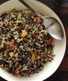 Wild Rice and Toasted Pecan Dressing: Love this recipe....the cranberries and toasted pecans add an ideal balance of savory and slightly sweet. The sage makes the house smell amazing as it cooks! #rice #recipe #vegetarian