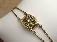 Watch Case Gold Bracelet Antiqued Filigree, Crystal, Chain Bracelet. $14.50, via Etsy.