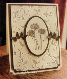 "By Charlene Merrick (LilLuvsStampin at Splitcoaststampers). Inked Cuttlebug ""Birds and Swirls"" embossing folder with Crumb Cake ink. Embossed Note the offset double stamping of the flowers done in Crumb Cake and Soft Suede Stampin' Up inks."