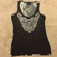 Gorgeous studded tank top by CYNTHIA ROWLEY sizeXS Gorgeous studded tank top by CYNTHIA ROWLEY nwot size XS. This top is so beautiful as the front features a very intricate studded design and back is a gorgeous silk floral print! So unique and eye-catching! Cynthia Rowley Tops Tank Tops