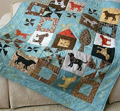 "Speedy fusible applique dog blocks stitch up fast and easy. 48"" x 56"" throw quilt."