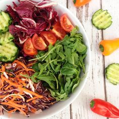 Raw pad thai, cucumbers, purple lettuce, spinach, cherry tomatoes