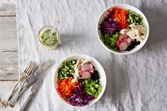 The star of this rice bowl isn't the shredded chicken or the assortment of raw vegetables, it's the fish sauce-spiked dressing.