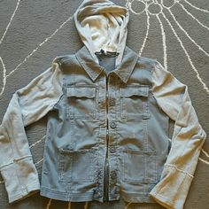 "SALE LTD TIME Free People Hoodie Jacket Super cute! Light dusty grayish blue color with zipper, hood and buttons. Sleeves and hood are a gray sweatshirt material. Can be worn all year long. I only wore this one time and got it caught on a chain link fence at a park! It snagged on the bottom right hand side as shown in 3rd pic. BUT... I sewed it and you can't even tell since the distressed look has little ""tears"" anyway!! Size medium. Fits a large. This brand runs larger. Free People Jackets…"