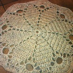 Crochet rug made with 3 strands worsted weight yarn and size N hook--the pattern is on my crochet board