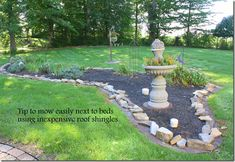use roof shingles around the borders of flower beds to make mowing easier, give a nice edge and keep weeds out! / pink peony of le jardin blog