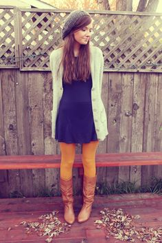 Mustard tights with navy dress, cardigan, boots, and beanie