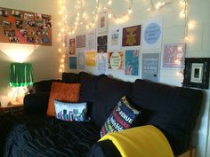 My Pinterest inspired dorm room:  *(4European+2bolster+3throw)pillows+comforter+throw+dorm bed=couch  *Print out, laminate, and tape up quotes to fill up a blank wall below twinkle lights scalloped with tiny command hooks  *Frame the light switch  *Glue ribbons around the top of a plain white lampshade  *Buy core board that looks like cork and prearrange photos before hanging