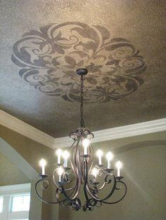 stencil a motif above a chandelier adds more interest without major remodel. - Fortune And Luxury Ceiling Finishes, Paint Finishes, Large Stencils, Foyer Lighting, Entry Chandelier, Foyer Decorating, Ceiling Medallions, My New Room, Decoration
