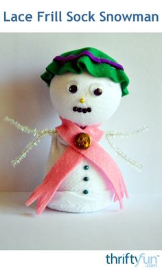 Turn a mismatched sock into a sweet little DIY snowman! #snowmancrafts #Christmascrafts