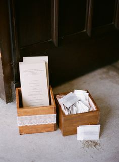 wooden boxes for order of service and confetti at the church