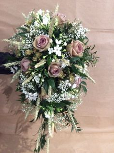 Amnesia rose shower bouquet combined with Gypsophilla, Bouvardia and Wheat.