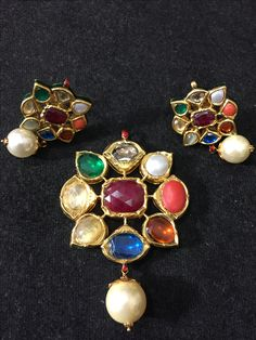Navratan ( nine precious gems ) pendant with earings . India Jewelry, Fine Jewelry, Women Jewelry, Antique Jewelry, Silver Jewelry, Vintage Jewelry, Indian Earrings, Gold Earrings, Gold Jewellery Design