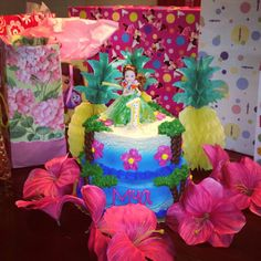 Hula party cake table. Hula girl made from mini Barbie and leftovers from Mya's custom birthday outfit! Perfect!