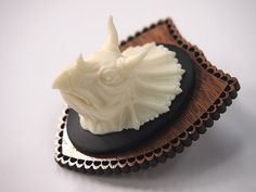 Mounted Dinosaur Triceratops Head on Dark Wood by HungryDesigns