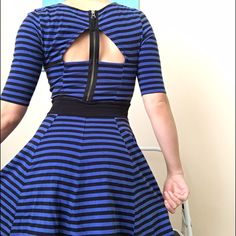 GUESS Blue and Black Striped Dress Blue and black striped dress by Guess. Does not have original tags - I cut them out so they wouldn't be itchy. Fits like a small/medium - can provide measurements. There is a zipper on the upper back, as shown in the first picture. Stretchy cotton-like fabric. The color is slightly faded from wear but it's still in very good condition. Please let me know if you have any questions below! Guess Dresses