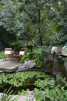 pond patio traditional with rock waterfall wooden side tables and ...