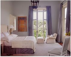 Such pretty colours! I like the mix of blue-violet curtains with the eggplant bed skirt.