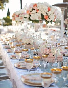 glass/clear candlelabras, white, light pink and coral florals, gold, peach/blush accents