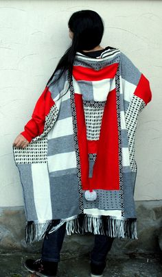 Reserved for Malia Storey, do not purchase this item.  Fantasy patchwork recycled sweater poncho. Made from recycled wool sweaters. Remade, reused and upcycled. Boho style. Very comfortable and useful. Warm, with hood. One of a kind.  Size: M-XL (free)  Wash in cold water gently.