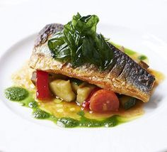 Pan-fried sea bass with ratatouille & basil. This restaurant-quality fish supper for two puts a new spin on classic French ratatouille