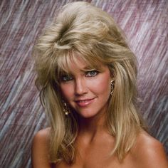 HEATHER LOCKLEAR - 1986 She took her feathered hair to new heights after her marriage to Motley Crue drummer Tommy Lee.