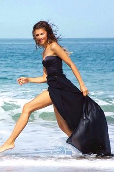 Zendaya wearing a awesome dress running wild and free