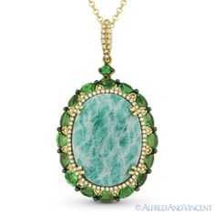 The featured pendant is cast in 14k yellow & black gold and showcases an oval cut amazonite & green garnets accentuated by round cut diamonds.  #diamonds #14kjewelry #14kgold #yellowgold #blackgold #pendant #necklace