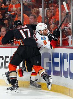 Ryan Kesler #17 of the Anaheim Ducks pins Dennis Wideman #6 of the Calgary Flames against the boards during the first period in Game One of the Western Conference Semifinals during the 2015 NHL Stanley Cup Playoffs at Honda Center on April 30