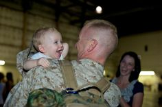 My husband deployed when our 2nd son, Logan, was 3 months old. 7 months later...he knows his daddy...and is so in love. I love my smile in the background! (military wife)