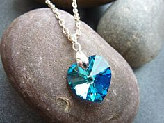 Swarovski Bermuda blue heart necklace on a silver plated chain. This is a very pretty heart pendant necklace, ideal for any occasion. This