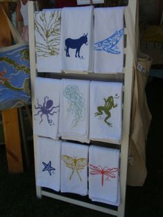 stand of screen printed dish towels