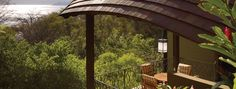 Built into the hillside with nearly panoramic views of the bay and gardens below, the treehouse-like canopies offered by the Four Seasons Resort at Peninsula Papagayo in Costa Rica could entice beach lovers looking for an exotic, high-end getaway. Peninsula Papagayo, Peninsula Hotel, Coast Hotels, Hotels And Resorts, Treehouse Hotel, Home Design Magazines, Costa Rica Travel, Four Seasons Hotel, Places To Go