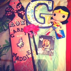 My perfect paddle and gifts from my perfect Little <3 sparkle . Sorority . Delta Phi Epsilon . DPhiE . Wonder Woman . Flower . Pink . Peach . Photo . Paddle . Greek . Letters .